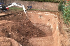 Excavating pool close to half done